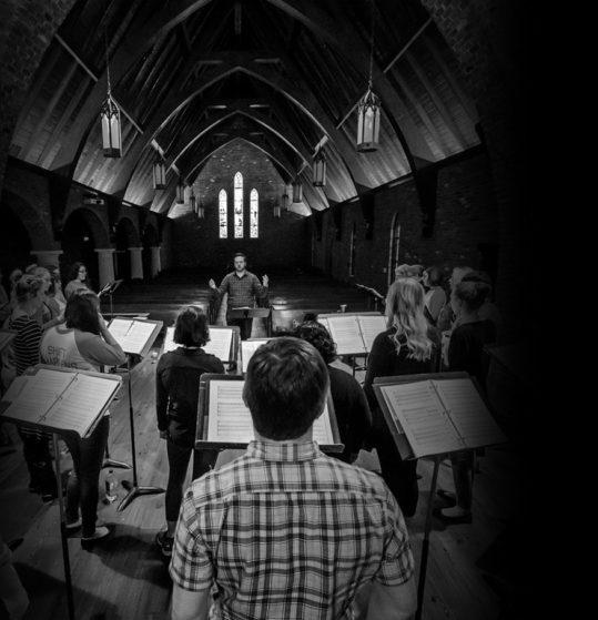 Trey Davis conducts the Red Shift Choir